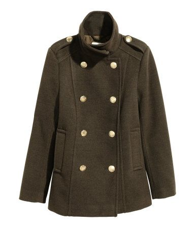 Khaki green. Gently fitted coat in thick, felted fabric. High collar, metal buttons at front, shoulder tabs with metal buttons, and welt side pockets. Lined