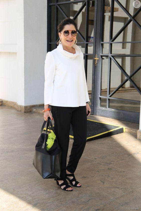A consultora Gloria Kalil escolheu um look clássico preto e branco