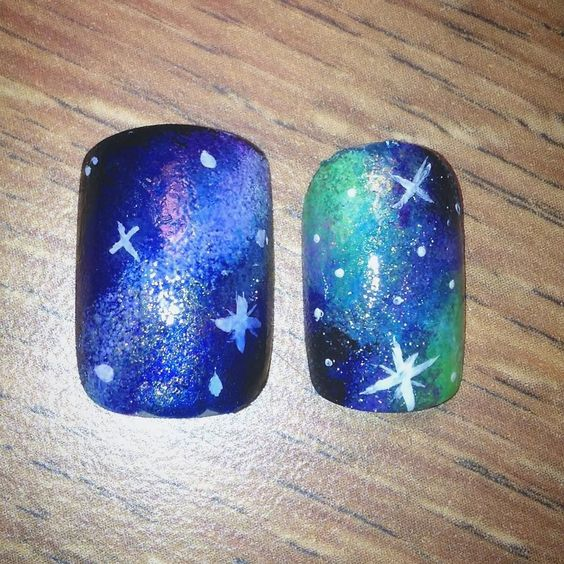 Galaxy nails... Preparing for my next nail design which is better? Left or right?  by genie_nailart