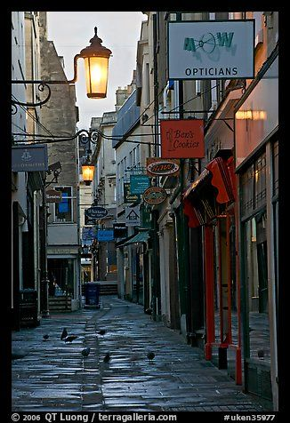 Lamps, pigeons, and narrow street. Bath, Somerset, England, United Kingdom (color)