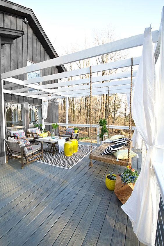 This deck makeover includes so many great outdoor decorating ideas, from a hang bench to modern cable railing. It's hard to choose our favorite. Great design work by Sarah Dorsey of Sarah M. Dorsey Design. See her deck makeover on The Home Depot Blog. || @smdorsey:
