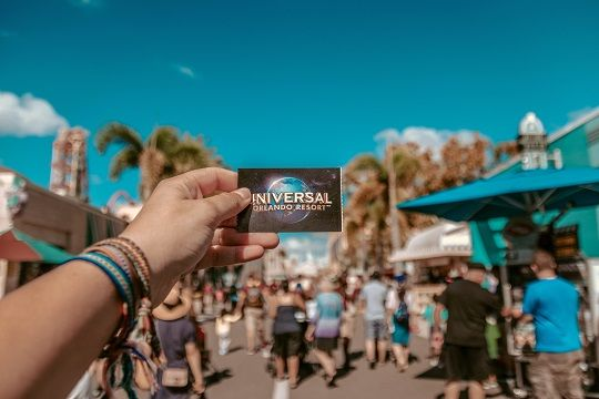 Person holding Universal Orlando Ticket
