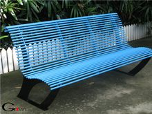customized metal street bench. round steel pipe seat pan. powder coated in blue and black.