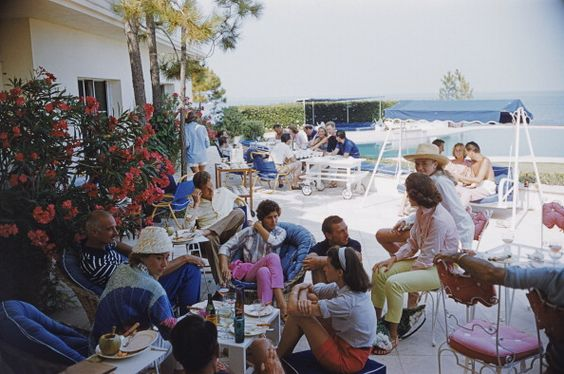 Riviera Crowd (© Slim Aarons): Holidaymakers enjoying lunch by a pool on the French Riviera.