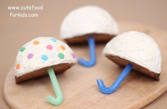 Umbrella Cupcakes (cute for a shower) - looks like cupcakes cut in half vertically, with colored straws inserted (though the open air cupcake would get crusty dry fast, so some icing there too might be nice to seal 'em).