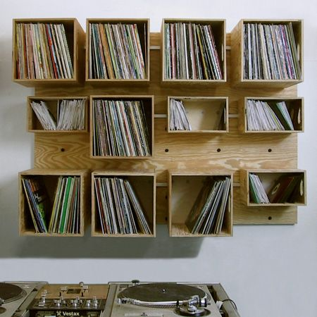 """DIY this record shelf out of 1/4"""" ply. Hide the bracket supports inside (covered by records) Mount against 1/2"""" ply. Pre-sink reverse directed screws into each shelves 4 corners."""