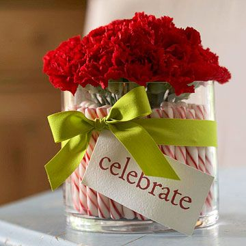 Peppermint Stick Centerpiece  Add a sweet touch to a simple floral arrangement with peppermint sticks. The striped candies stand as straight as sentinels, thanks to some clever structuring.