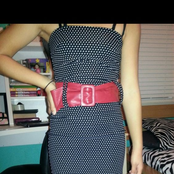 Polka dot dress with red belt This dress is great for a nice dinner or a girls night out! Dresses