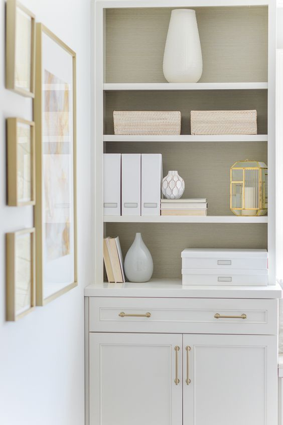 Organized office built in shelves with baskets and grass cloth