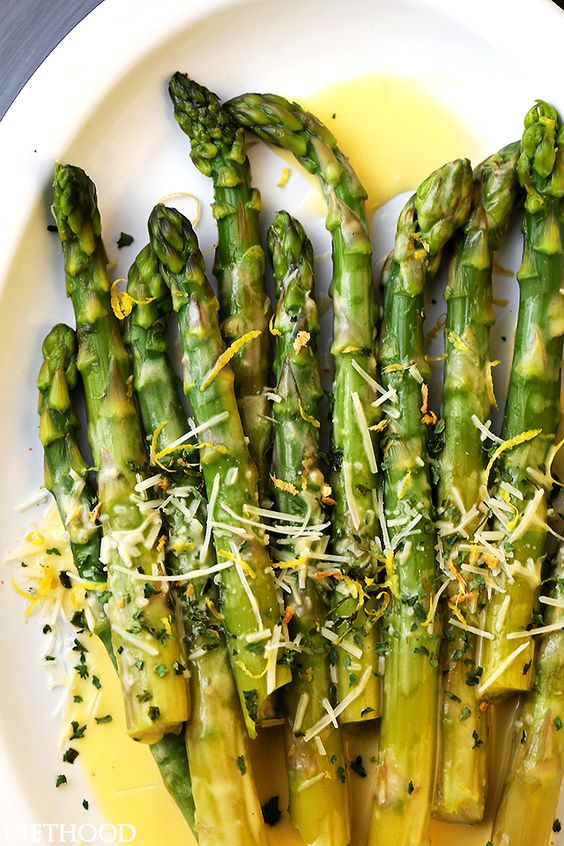 Asparagus with Lemon Butter Sauce - Budget friendly, quick, and easy crisp-tender asparagus drizzled with an amazing lemon butter sauce and a sprinkle of parmesan cheese. The BEST asparagus side dish of ever!