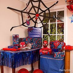 Too cool! Make a web from streamers and paper cutouts from a Spider-Man swirl decorations kit. An easy and affordable way to get an awesome web-slingin' look!