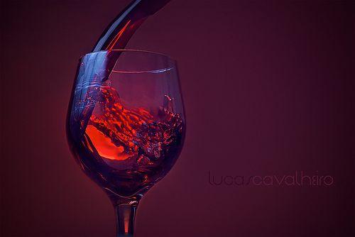 strobist: through umbrella @ camera left flash with red and blue gel @ background