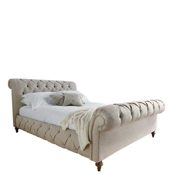 The Edworth High End Bed Frame will add elegant style to your bedroom with its natural upholstered and buttoned finish.