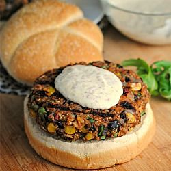 Black Bean & Quinoa Veggie Burgers - ½ cup dry quinoa 1 tsp olive oil 1/2 red onion, chopped 3 cloves garlic, minced 1/2 tsp Kosher salt, divided 1 (15 oz) can black beans, drained and rinsed 2 Tbsp tomato paste 1 large egg 2/3 cup frozen corn 1/2 cup cilantro, chopped 1 chipotle in adobo, minced 2 tsp ground cumin 1/2 cup rolled oats 1/4 cup oat flour