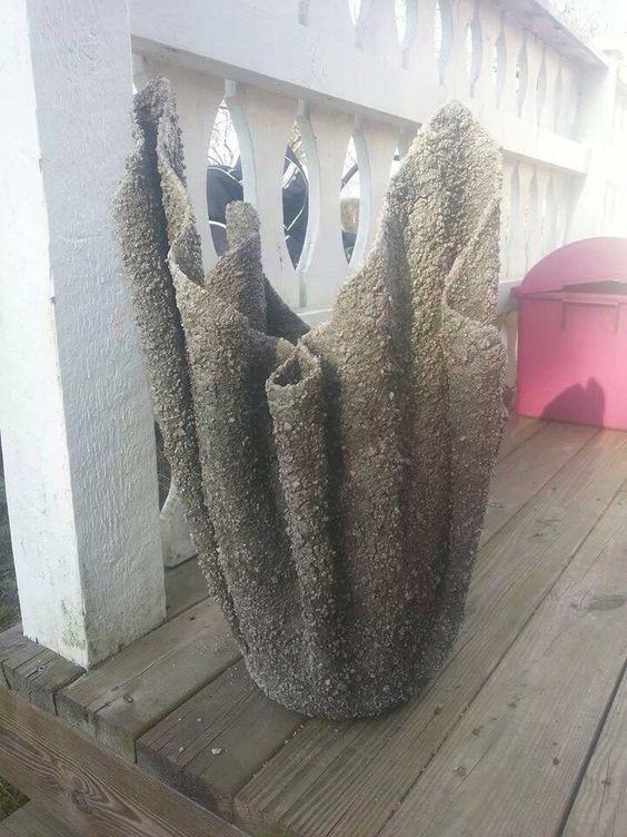 Kruka av betong o handduk