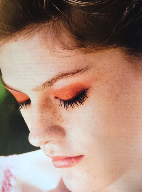 Black eyeliner and apricot  eyeshadow