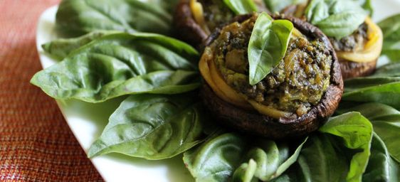 Plump mushrooms stuffed with pasta and creamy sunflower seed pesto. By Plant Based on a Budget.