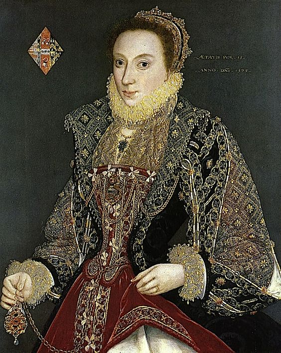 1573 Mary Denton attributed to George Gower (York City Art Gallery, UK)  An elaborately ornate gown, typical of the latter Tudor Period, the Elizabethan Age.   Excerpt: She appears to be wearing a black over-skirt that merges with a bodice set off by embroidered revers from a maroon stomacher that matches her under-skirt or kirtle that in turn covers a white petticoat or lining.