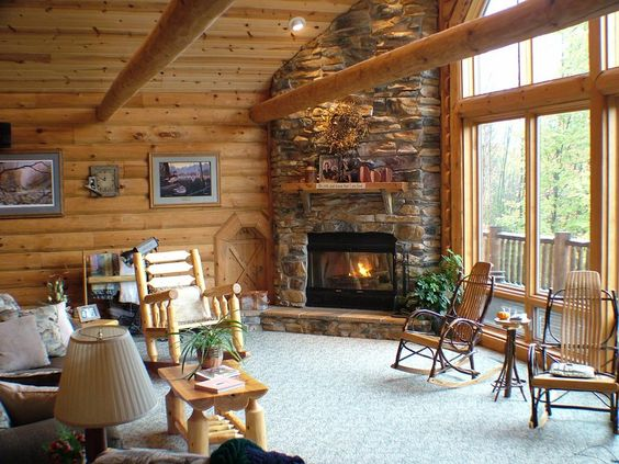 Log cabins corner fireplace love log cabins american for Cabin fireplace pictures