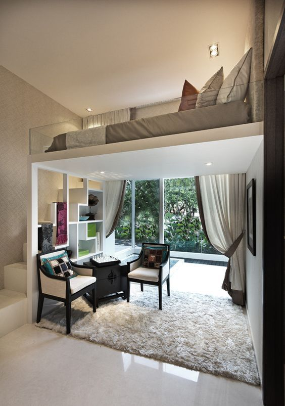 The image above shows an ideal loft bedding design above the living room, a perfect solution for small spaces that is to cater multiple spaces in an organized manner. Again the staircase is designed perfectly for storage and sleeping space above is in soft and neutral tones for a very warm and comfortable environment.