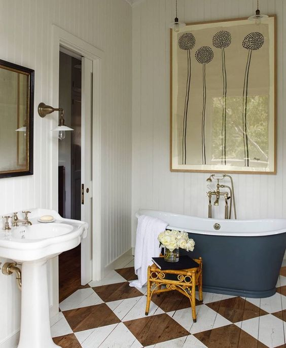 Blue cast iron bath, chequer painted floor
