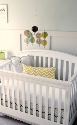 Board & batten, chevron, vintage touches, and a DIY hot air balloon mobile - love this nursery!