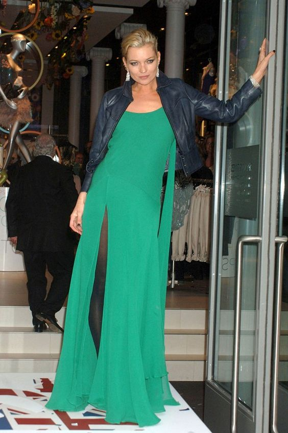 Kate Moss in a long green dress and blue leather jacket at Topshop