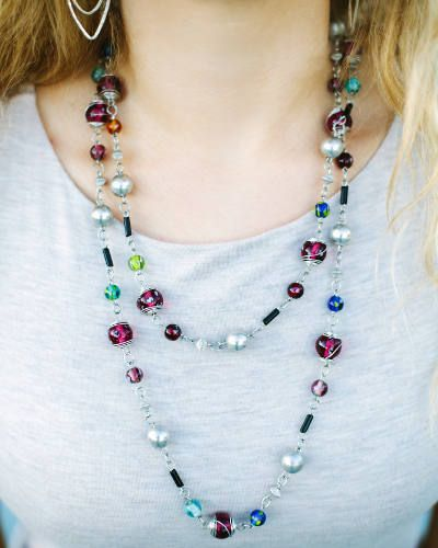 This Jeweled Necklace is handcrafted by artisans in India, it comes in a multitude of beautiful colors. This beautiful necklace is highlighted by glass beads and comes in an endless design. You can wear it with its full length or it can be wrapped.   Trades of Hope - Jeweled Necklace