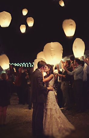 Guest Making Wishes for the Newlyweds - Floating Paper Lanterns