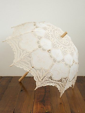Vintage Parasol Umbrella  Style: 21194006  Gorgeous Victorian-inspired fabric parasol with detailed crochet trim. Wooden handle with metal spokes. We advise opening this special item very gently. Due to the uniqueness of this product, you might not receive the exact one pictured.