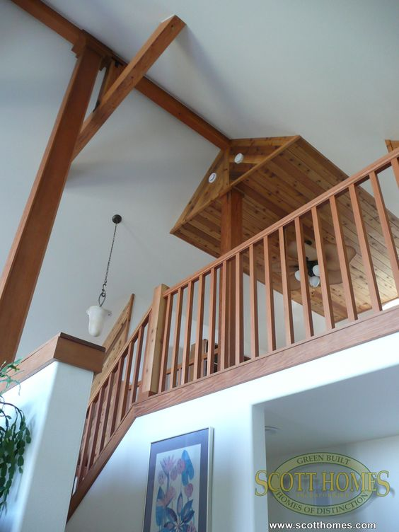 The vaulted ceilings in the main living area leaves the loft to look down over the entrance.