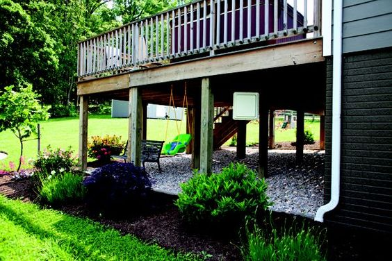 Landscaping around a deck landscaping and stones under for Landscaping ideas around deck
