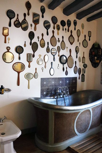 This bathroom has really elegant maximalist style, but features texture (hello cane detailing on the bathtub!), and different finishes with all of the beautiful hand mirrors. What's especially great, from a function standpoint, is that hand mirrors are typically made to be in bathrooms, so you know the moisture won't ruin them.
