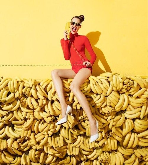 girl sat on bananas