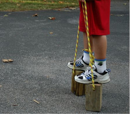 Wooden Walking Stilts  Some of my favorite toy catalogs to get inspired gift making ideas from are:  www.bellalunatoys.com and www.thewoodenwagon.com    What you need:  1. 4×4 chunks of wood  2. Rope    1. Cut your 4×4 into chunks that you feel are the appropriate height for your child.  2. Sand to round the edges. (Must do this)  3. Drill a hole near the top all the way through.  4. Thread your rope through and tie.