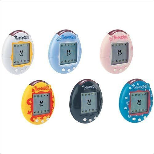 Tamagotchi, Nano Pets... can't remember which I had, but they were neat little things.