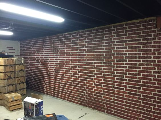 Painted brick form poured concrete basement walls with ceiling painted black basement - Basement concrete wall ideas ...