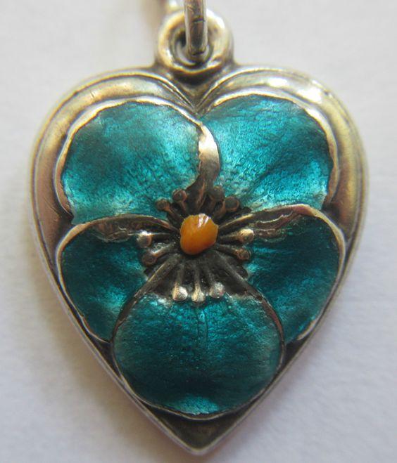 VTG STERLING SILVER BLUE ENAMEL PANSY FLOWER PUFFY HEART CHARM.  I have a puffy heart vintage bracelet. Sold 152.00