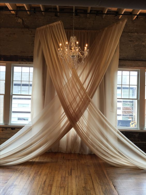 Party Tables fabric, installed by Get Lit, create an elegant backdrop for our Murano crystal chandelier, and a wedding ceremony. Venue: The Stockroom, Raleigh: