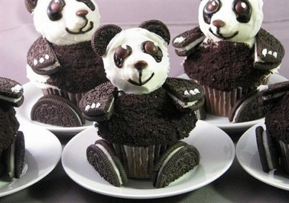 Panda Bear Cupcakes!    The head is made out of a mini cupcake set on it's side.  The body is a cupcake iced and ground up oreos sprinkled on it.