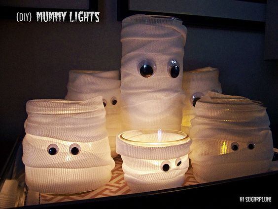 Mummy lights - Jars, gauze, candle, and googly eyes.