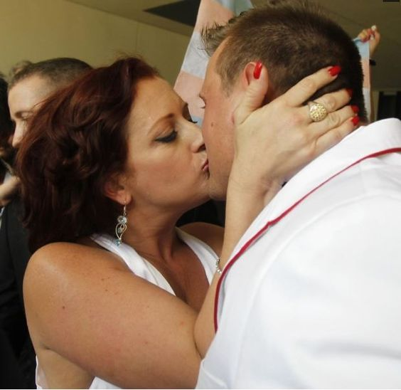 Nikki Araguz kisses her new husband, William Loyd. The couple got married after Araguz's hearing in the Thirteenth Court of Appeals to recognise her as a female to enable the wedding.