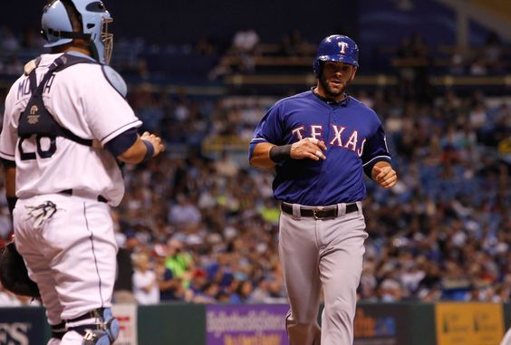 CrowdCam Hot Shot: Texas Rangers first baseman Mitch Moreland runs home and scores a run during the second inning against the Tampa Bay Rays at Tropicana Field. Photo by Kim Klement