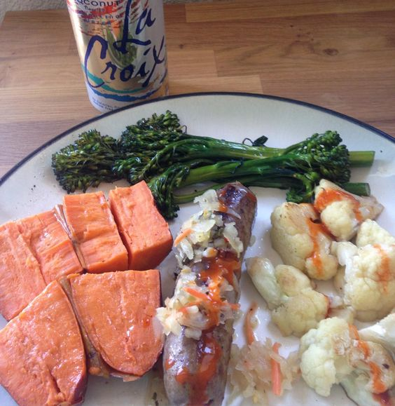 Day 36 Lunch...sweet potato brat with kraut broccolini cauliflower topped with Frank's wing sauce and a coconut #lacroix. #whole30 #paleo by mywholelifeinco