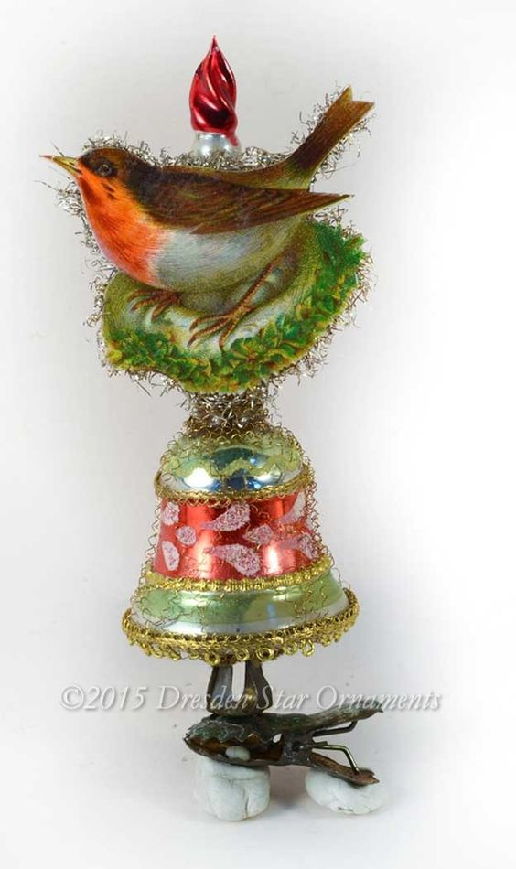 Dresden Star Ornaments - Red Robin on Mid-Century Glass Bell with Candle-Clip, $149.95 (http://www.victorianornaments.com/red-robin-on-mid-century-glass-bell-with-candle-clip/)