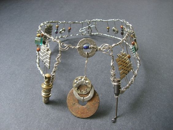 The Machinist's Collar. Stainless steel wire, found objects, glass beads.