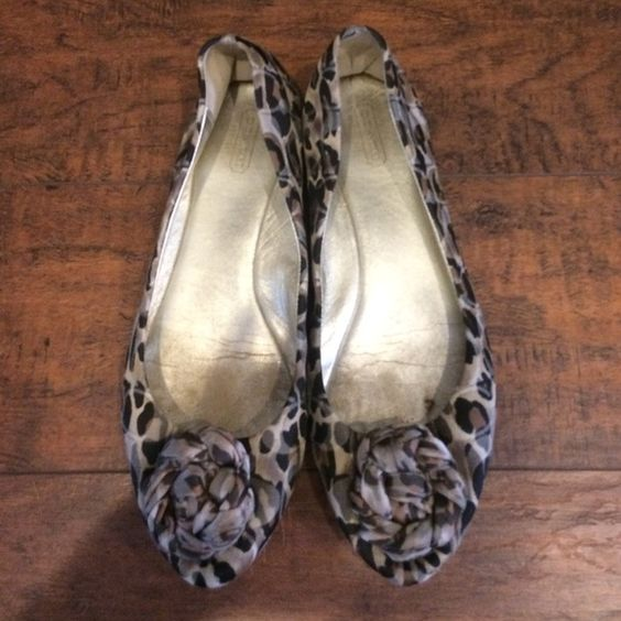 Size 10 Coach leopard print shoes! Size 10 Coach flats.  Worn a lot because I loved them so much!!  But all pieces are still in place and they have more life on them!   Coach Shoes Flats & Loafers