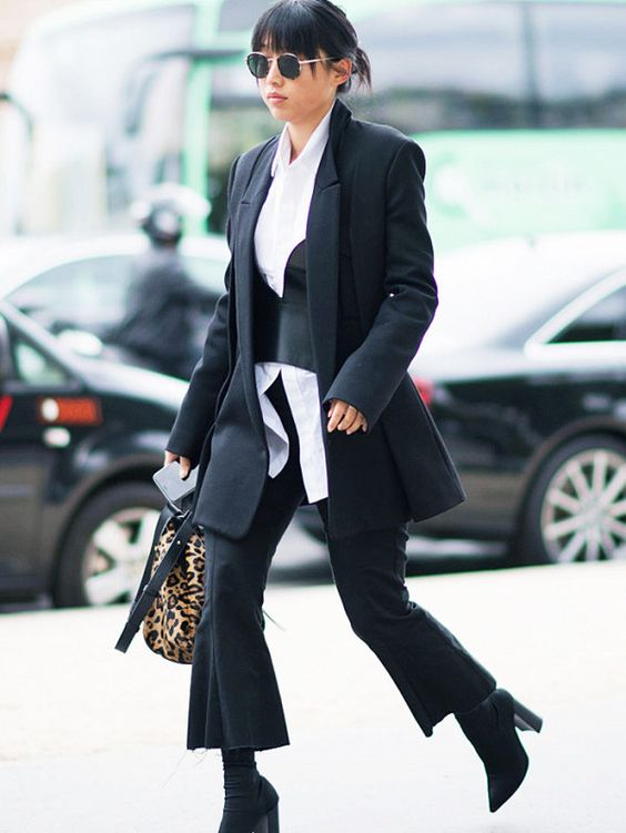 layering clothes: Margaret Zhang layers a corset, shirt and blazer