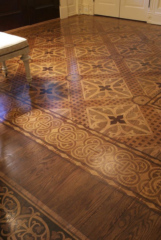 Stenciled and stained faux marquetry floor. Would be SO easy to do with Modello® Designs masking stencils :):