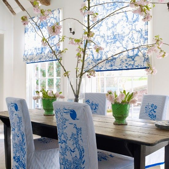 The classic combination of blue and white is an enduring favourite. It has been given depth with loose chair covers stencilled in a variety of cobalt-blue motifs, bringing a new dimension to toile de jouy. Roman blinds in an historical print keep the simple feel both fresh and uplifting.: